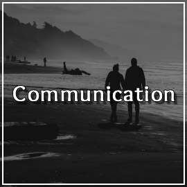 Couple walks hand in hand deep in conversation. Articles on the topic of Communication in Happy Relationships can be found on this page
