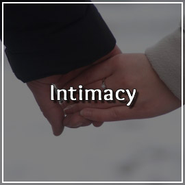 Close-up of couple holding hands. Articles on the topic of Intimacy in Happy Relationships can be found on this page