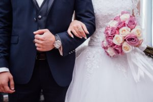 A bride and groom arm-in-arm, like you were at the start of your relationship - connected and committed