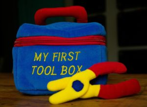 A child's first toolit represents how communication needs tools
