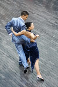 Healing is a like dancing a complex tango, like this competition couple on an outdoors dance floor